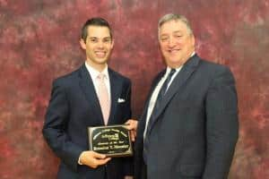 Brandon Moonier (left) is presented the 2016 Jefferson College Alumnus of the Year Award from Vice President of Finance and Administration Daryl Gehbauer.